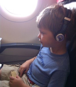 Cian watching a video on the plane.
