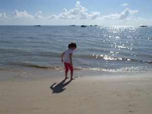 Aine scouring the shore for sea treasures