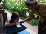 Aine learning to sign the bill. Oh, no!