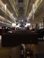 Having a Singha in the lobby bar