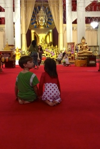 Cian and Aine paying their respects to the Buddha
