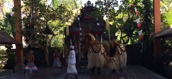 The Barong and a priest watching over devotees in trance