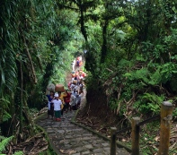 A procession heading to the top temple