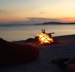 Fire, sunset, and Gunung Agung in the distance