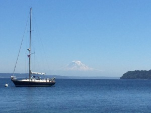 Kim and Greg's sailboat with Mt. Rainer in the distance. Photo Adrian Horton