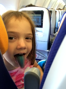 Showing off her lollipop tongue on the flight to Lagos