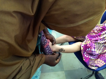 Aine getting a henna tattoo