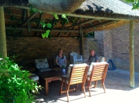 Relaxing under the thatch gazebo next to the pool