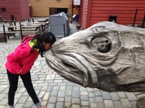 Kissing a dried fish statue. Oh, Norway