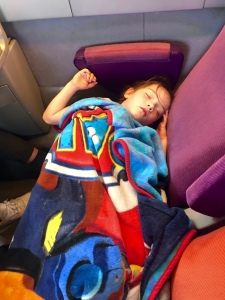 Aine fighting off a fever on the train to Agen