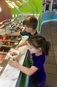 Helping yourself with frozen yogurt toppings