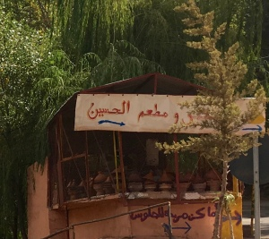 Tagines simmering at a traditional restaurant